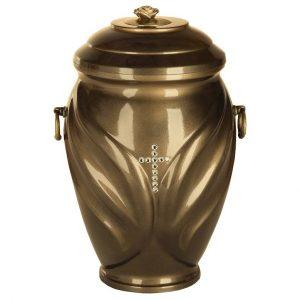 Bronzos spalvos urna dekoruotu paviršiumi ir kryželiu